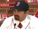 adrian-gonzalez-dons-red-sox-jersey
