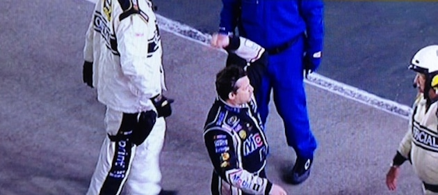 tony-stewart-motions-to-the-crowd-after-throwing-his-helmet-at-matt-kenseths-car