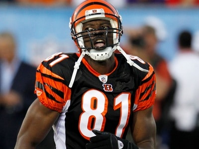 Cincinnati Bengals wide receiver Terrell Owens runs back to the line of scrimmage in the first quarter of the Hall of Fame NFL football game against the Dallas Cowboys Sunday, Aug. 8, 2010, in Canton, Ohio. (AP Photo/Ron Schwane)