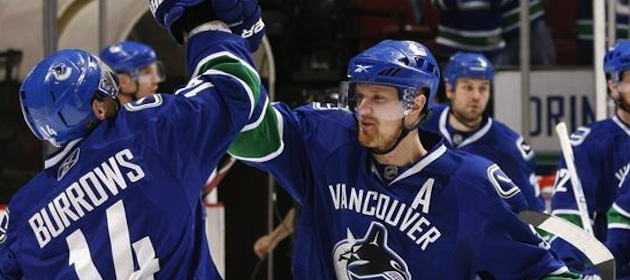 henrik-sedin-celebrates-with-vancouver-teammates